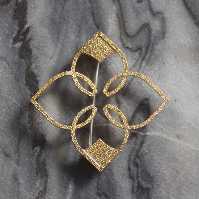 quatrefoil brooch